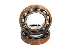 Old and rusty ball bearing, isolated on white background Royalty Free Stock Image