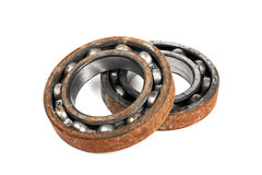 Old and rusty ball bearing, isolated on white background Stock Photos