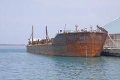Old rusty barge. A very rusty barge parked at a pier Stock Photos