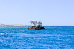 Old Rusty Barge floating on the Sea Royalty Free Stock Photos