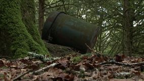 An old rusty barrel in the forest