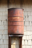Old rusty barrel for rainwater Royalty Free Stock Photo