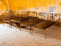 Old rusty beds in abandoned room Stock Images