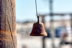 Old rusty bell in sunset light Royalty Free Stock Image