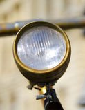 Old and rusty bicycle lamp. With metal cover Royalty Free Stock Photo