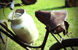 Old rusty bicycle milkman and the Milk Canister. Old rusty bicycle of milkman and the Milk Canister Stock Images