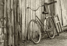 Old rusty bicycle near an ancient barn Royalty Free Stock Image