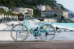 Old rusty bicycle with a wicker basket on the background of the turquoise sea. royalty free stock photo