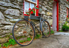 Old rusty bike. An old rusty bike at Irish cottage house stock image