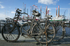 Old rusty bike at Amsterdam dock Stock Images