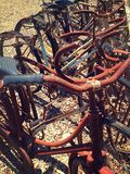 Old rusty bikes. A row of old rusty bikes in a row Royalty Free Stock Photos