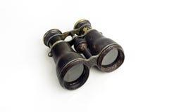 Old Rusty Binoculars Search. Antique, rusty metal binoculars on white Royalty Free Stock Image