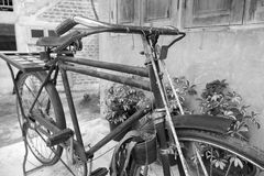 Old rusty black bicycle Stock Photo