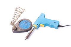 Old rusty blue soldering iron standing on the holder, isolated o Stock Photography