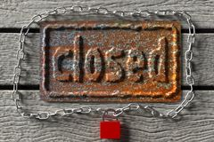 Closed. Old rusty board with an inscription `closed`, 3d rendering Stock Image
