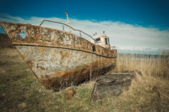 Old rusty boat. Abandonment boat lying on the shore Royalty Free Stock Photos