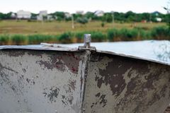 Old rusty boat bow, scraped, vintage, colorful. Landscape at the river royalty free stock images
