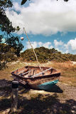 Old rusty boat on the grass. In autumn Royalty Free Stock Photos