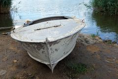 Old rusty boat, scraped, vintage, colorful. At the river side royalty free stock photos