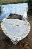 Old rusty boat, scraped, vintage, colorful. With river background for fishing stock images