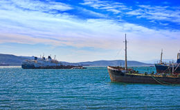 Old rusty boats. Side by side at a mooring, Eleusis bay - Greece Stock Image