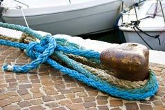 Old rusty bollard on the pier Stock Photography