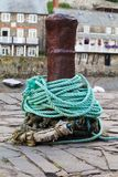 An old rusty bollard on a quayside Royalty Free Stock Image