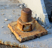 An Old Rusty Bolt and Nut in a Metal Plate Stock Photos