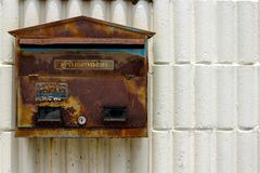 Old mail box that is rusty color peeling. stock photo
