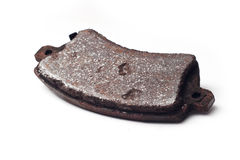 Old rusty brake pad isolated. On white background Stock Photography