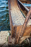 Old rusty bridge with rivets. Old abandoned bridge with wrought iron rivets Royalty Free Stock Photo