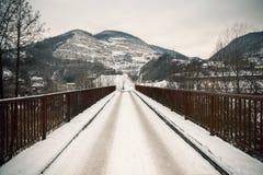 Old rusty bridge under snow Stock Photo