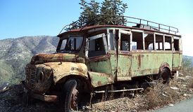 Old rusty abandoned bus on a mountain road border stock photos