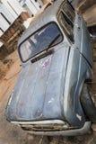 Old rusty broken blue car Stock Photo