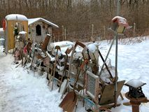 Old rusty broken junk for sale on display in snowy northern Minnesota stock photos