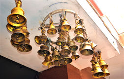 Old rusty bronze bells in a temple Stock Images