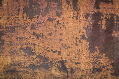 Old rusty brown metal wall closeup. Brown painted abandoned weathered old rusty metal wall Royalty Free Stock Photography