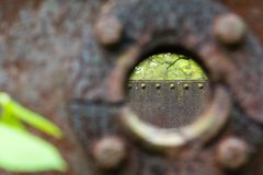 Old rusty tank with a hole. Old rusty brown tank with a blurry hole Royalty Free Stock Photos