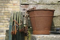 Old rusty bucket. A closeup of an old and rusty bucket. It is nice that items like these passed time so well and tell a story of times long ago stock photography