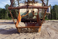 Old rusty bucket giant mining excavators Stock Images