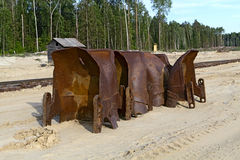 Old rusty buckets of giant mining excavators Royalty Free Stock Photo