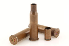 Old rusty bullet casings on a white background Royalty Free Stock Photography