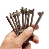 Old rusty bunch of keys in hand royalty free stock images
