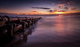 The old rusty Cambois Pipe in Blyth, Northumberland royalty free stock photography