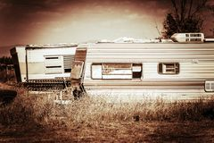 Old Rusty Campers. In Some Rural American Area. Trailer Park Living. Browny Sepia Color Grading royalty free stock image