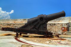 Old rusty cannon on a castle Stock Photos