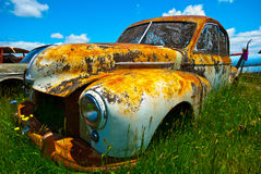 Old rusty car. Image of old rusty vintage car at junk yard Stock Photos