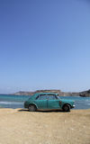 An old rusty car abandoned on a beach. An old battered Austin abandone on a beautiful barren beach Royalty Free Stock Images