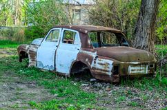 Old rusty car body. On a ground Stock Photo