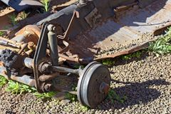 Old rusty car chassis. With wheels, shock absorber and transmission Stock Images